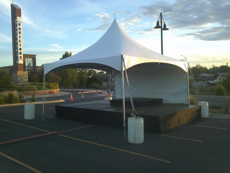 A Typical 20x20 Tent with Panel Stage underneath! & S.S.S. Productions